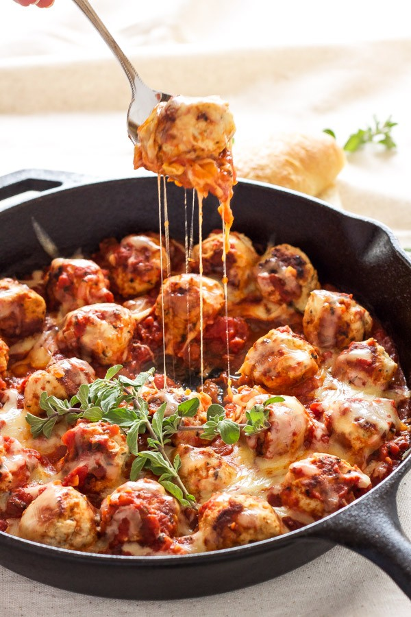 Easy To Make Turkey Meatballs Stuffed With Mozzarella Cheese And Simmered In Marinara Sauce