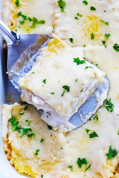 Saucy, Cheesy White Chicken Lasagna Made In Your Slow Cooker!